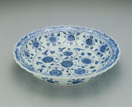 Lotus-shaped dish with floral design in underglaze blue