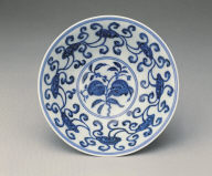 Stem bowl with design of fungus and grapes in undergraze blue