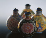 Glass bodied painted enamel snuff bottle (set of four)