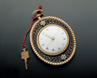 Gilt oval pocket watch inlaid with pearls and jewels