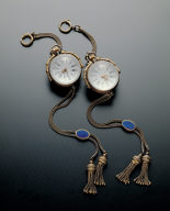 Pair of transparent globular pocket watches