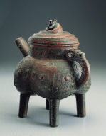 Bronze He vessel with interlacing dragon motif