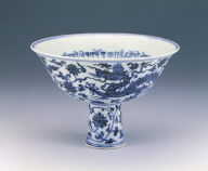A blue-and-white double-dragon stembowl with Sanskrit characters
