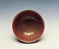 A molded copper-red bowl