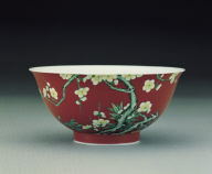 A famille rose ruby-ground bowl with plum blossoms and bamboo