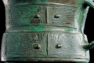 Bronze Jia vessel with animal mask decor