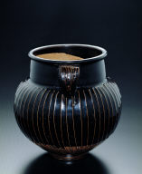 Black-glazed jar with raised striations