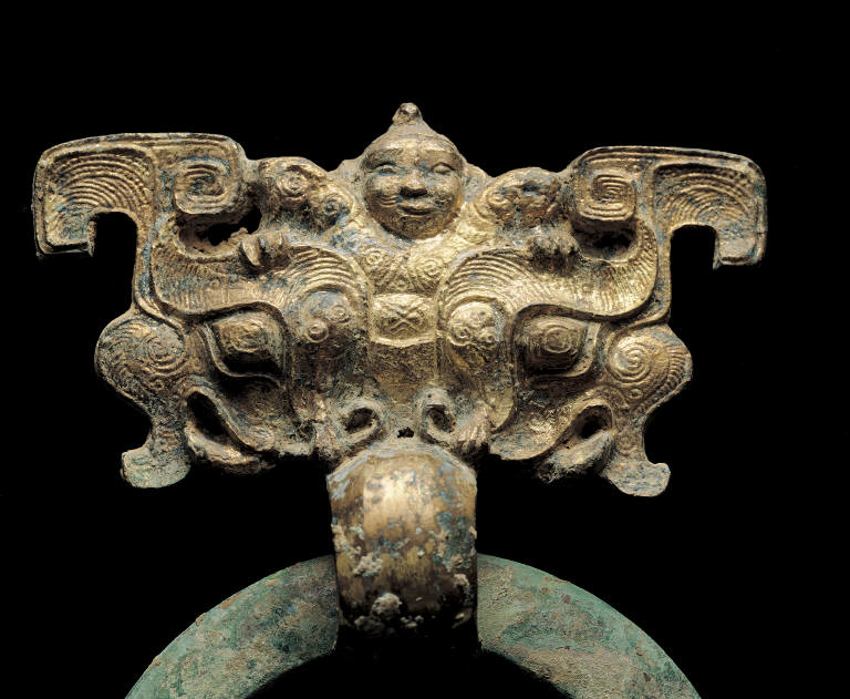 Bronze knocker with human mask decor